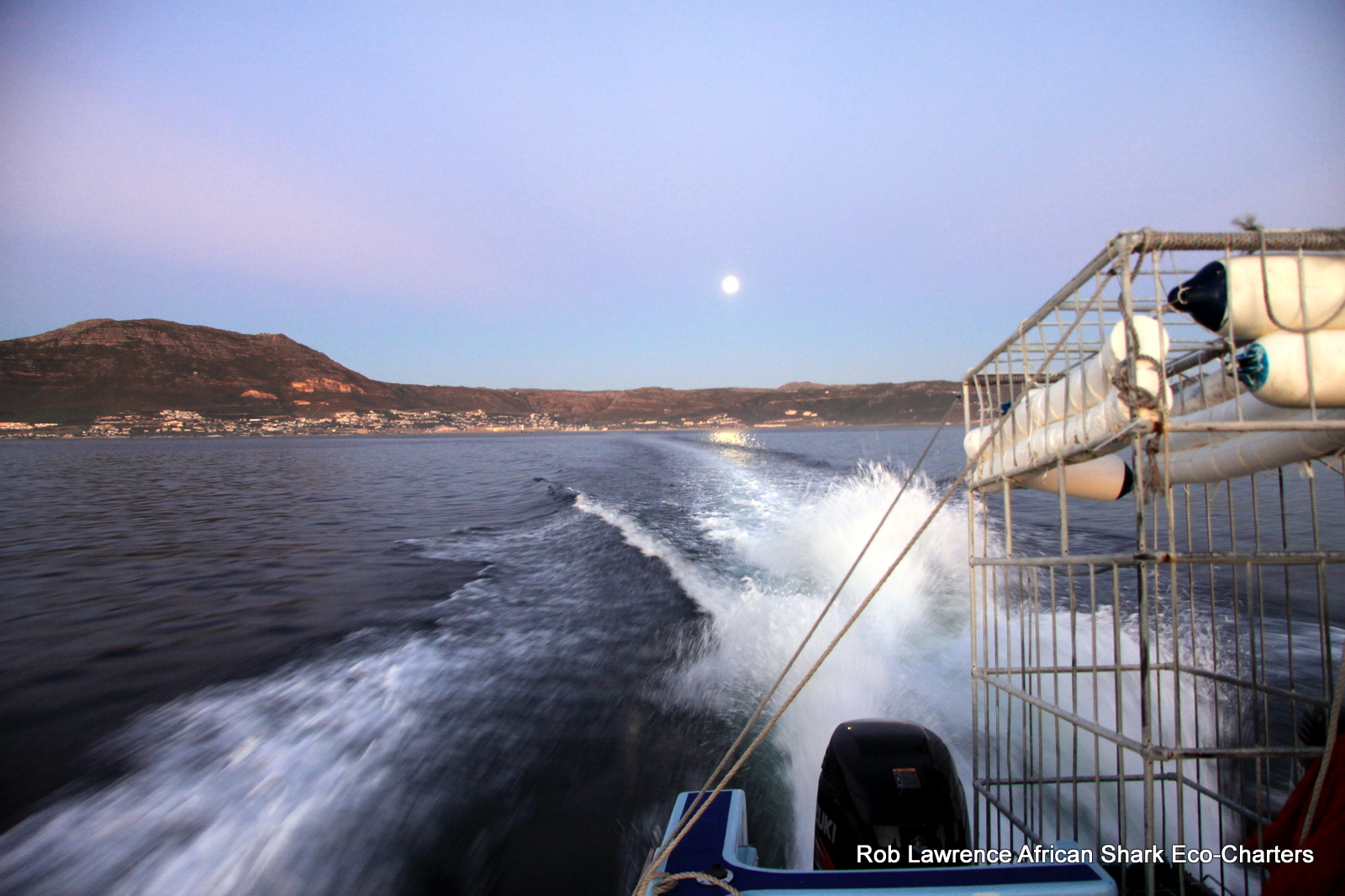 Heading off to Seal Island, False Bay at dawn. Moon still up.